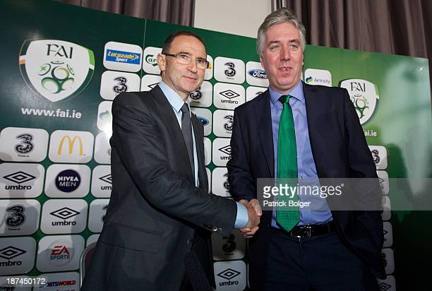 Newly appointed Republic of Ireland manager Martin O'Neill shakes hands with John Delaney Chief Executive of the FAI during a press conference at...
