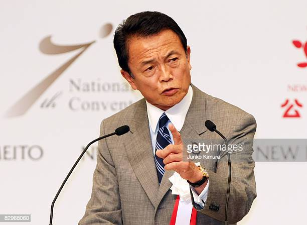 Newly appointed ruling Liberal Democratic Party president Taro Aso speaks during the New Komeito's National Convention at Toshi Center Hotel on...
