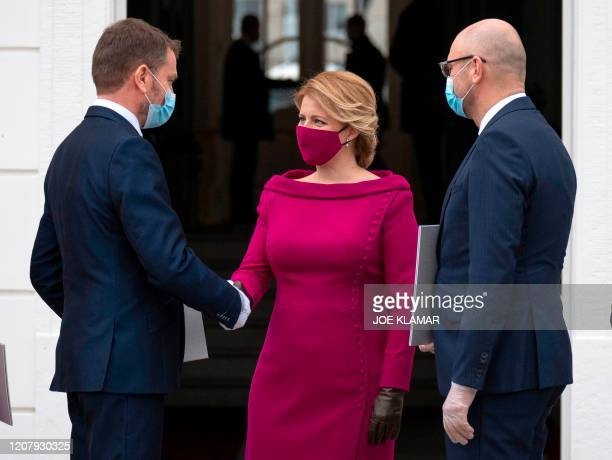 Newly appointed Slovak Prime Minister Igor Matovic , leader of the OLaNO anti-graft party shakes hands with President Zuzana Caputova after a...
