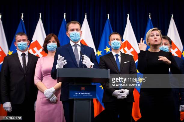 Newly appointed Slovak Prime Minister Igor Matovic, leader of the OLaNO anti-graft party and his ministers of the new government attend a press...