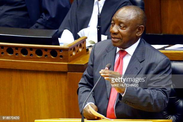 Newly appointed South African President Cyril Ramaphosa gestures as he delivers a speech after being elected by the Members of Parliament during his...
