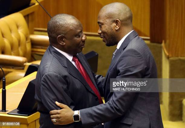 Newly appointed South African President Cyril Ramaphosa is congratulated by Democratic Alliance Party leader Mmusi Maimane after being elected by the...