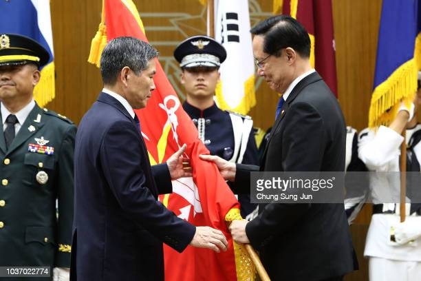 Newly appointed South Korean Defence Minister Jeong Kyeongdoo receives the South Korea's defence ministry flag from outgoing minister Song Youngmoo...