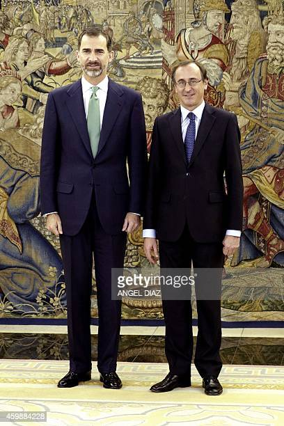 Newly appointed Spanish Health Minister Alfonso Alonso poses with Spain's King Felipe VI after taking an oath as minister at the Zarzuela Palace in...