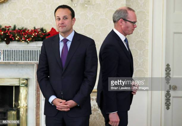 Newly appointed Tanaiste Simon Coveney walks past Taoiseach Leo Varadkar at the Aras in Dublin following the resignation of Frances Fitzgerald over...