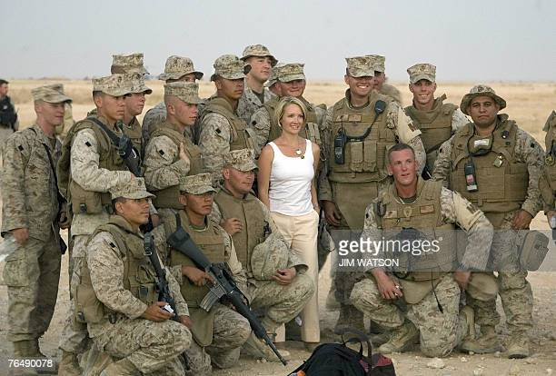 Newly appointed White House Press Secretary Dana Perino poses with US Marines as US President George W Bush tours AlAsad Air Base in Anbar Province...
