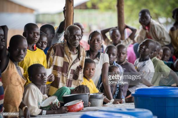 Newly arrived Congolese refugees seen waiting for their food distribution at the Kyangwali refugee camp According to the UNHCR over 85000 people have...
