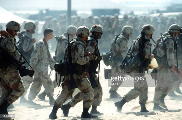Newly arrived Marines are led through an encampment near an airfield during Operation Desert Shield