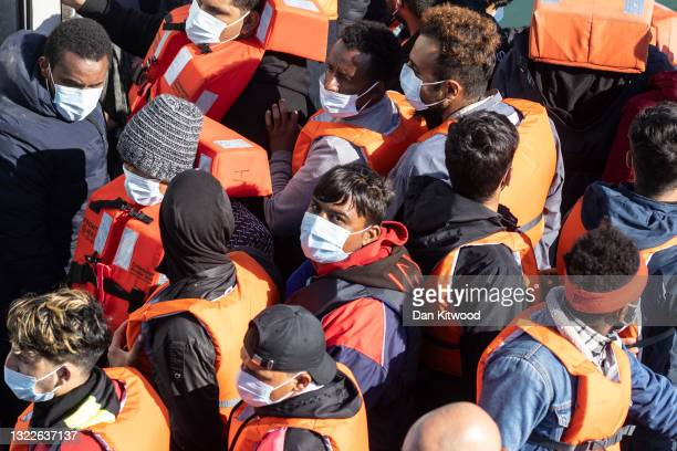 Newly arrived migrants wait to disembark a Border Force vessel after being picked up in a dinghy in the English Channel on June 09, 2021 in Dover,...