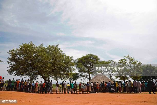 TOPSHOT Newly arrived refugees from South Sudan queue in line waiting to be registered on April 11 2017 at Ngomoromo border post to be transferred...