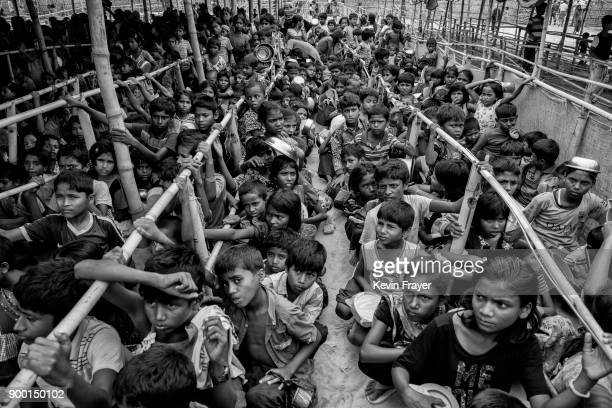 COX'S BAZAR BANGLADESH OCTOBER 28 Newly arrived Rohingya refugee children waiting for a hot meal air the Palong Khali camp on October 28 2017 near...