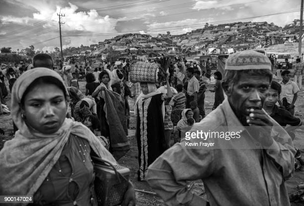 COX'S BAZAR BANGLADESH OCTOBER 01 Newly arrived Rohingya refugees gather after arriving at the Palong Khali Refugee Camp on October 1 2017 in Cox's...