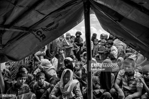 COX'S BAZAR BANGLADESH OCTOBER 29 Newly arrived Rohingya refugees wait to be registered by IOM after arriving at Shah Porir Dwip on October 29 2017...