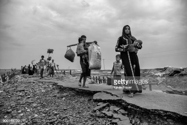 COX'S BAZAR BANGLADESH OCTOBER 29 Newly arrived Rohingya refugees walk after arriving at Shah Porir Dwip on October 29 2017 near Cox's Bazar...