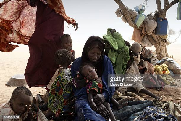 Newly arrived Sudanese refugees who escaped bombing from the Sudanese air force in their villages in Darfur seat under trees as they wait for...