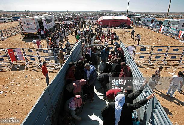 A newly arrived Syrian Kurdish refugees wait in a truck after crossing into Turkey near the southeastern Turkish town of Suruc in Sanliurfa province...