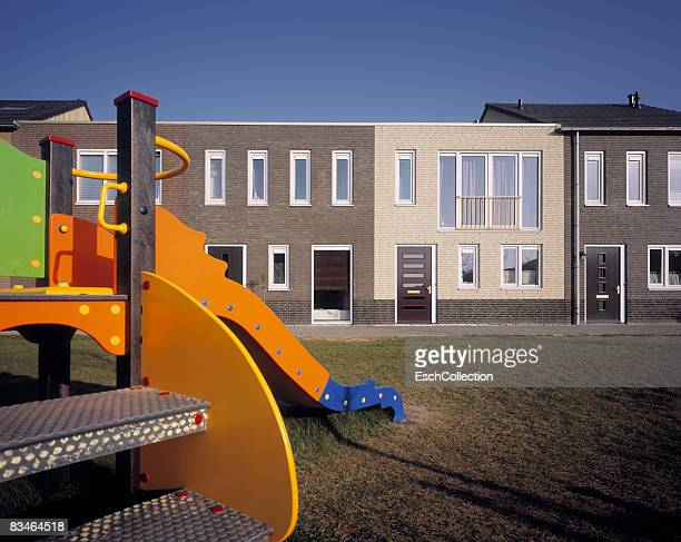 newly buillt homes with playground attraction - almere stock pictures, royalty-free photos & images