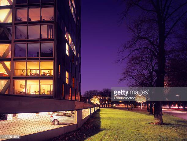 newly built apartment building at dusk. - breda stock pictures, royalty-free photos & images