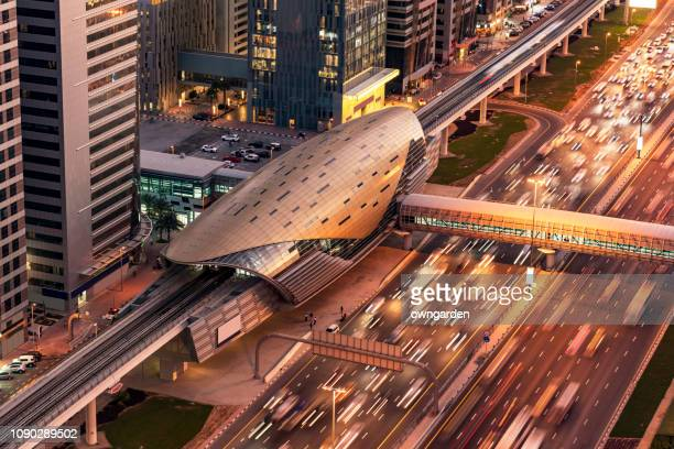 newly built futuristic metro station at the business bay area of dubai, uae - station stock pictures, royalty-free photos & images