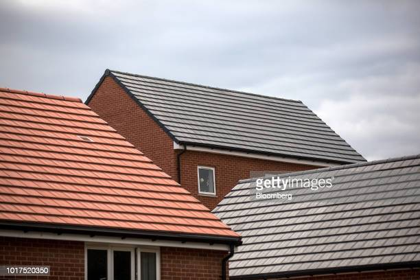 Newly built homes sit at a Persimmon Plc residential construction site in Grays UK on Tuesday Aug 14 2018 Persimmon are due to report their first...