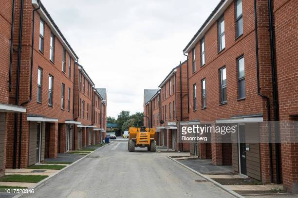Newly built homes stand at a Persimmon Plc residential construction site in Grays UK on Tuesday Aug 14 2018 Persimmon are due to report their first...