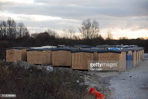Newly built huts are pictured in the 'jungle' migrant camp on February 29 2016 in Calais France The French authorities have begun dismantling part of...