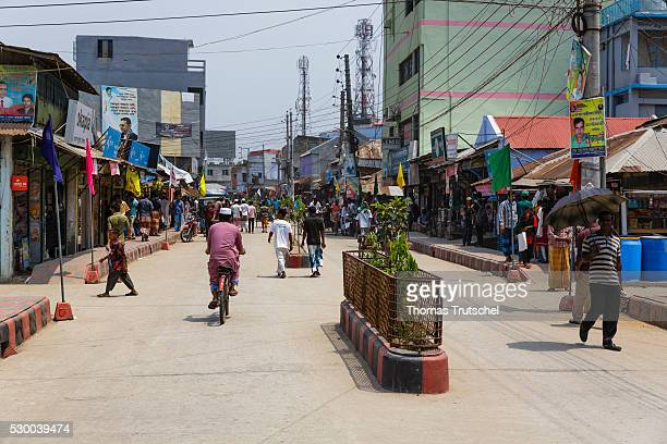 Newly built road with planted median strip in the town of Mongla in the southwest of Bangladesh on April 12 2016 in Mongla Bangladesh