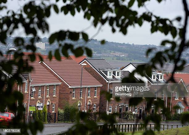 Newly built semi-detached residential houses stands in Newcastle-upon-Tyne, U.K., on Wednesday, Sept. 11, 2013. U.K. House prices rose for a seventh...