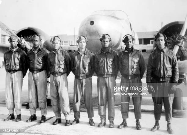 Newly commissioned single and twin engine pilots Tuskegee Airmen at Tuskegee Army Airfield during World War 2 with a twin engine airplane Tuskegee...