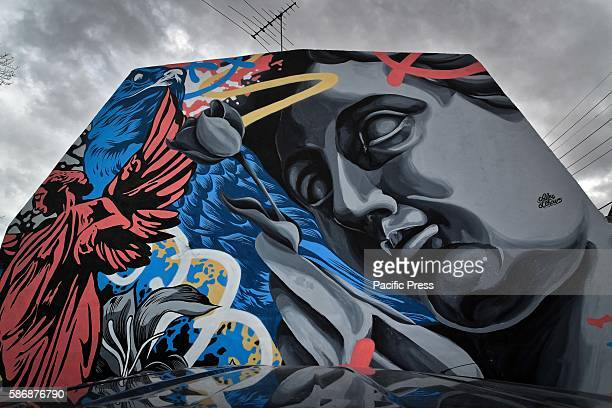 A newly commissioned street artwork on the side of terrace house in Newtown as part of the 2016 Perfect Match program in Sydney Australia Perfect...