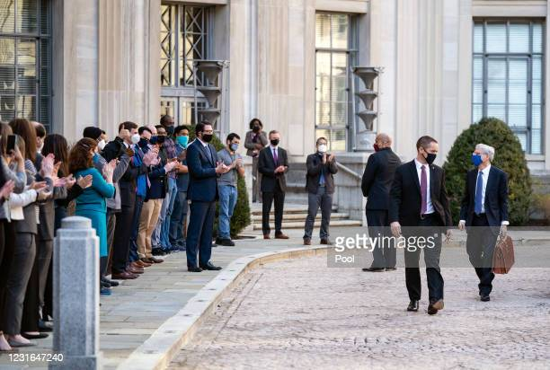 Newly confirmed U.S. Attorney General Merrick Garland is greeted by staff as he arrives for his first day at the Department of Justice March 11, 2021...