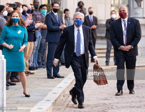 Newly confirmed U.S. Attorney General Merrick Garland is greeted by staff as his wife Lynn looks on as he arrives for his first day at the Department...