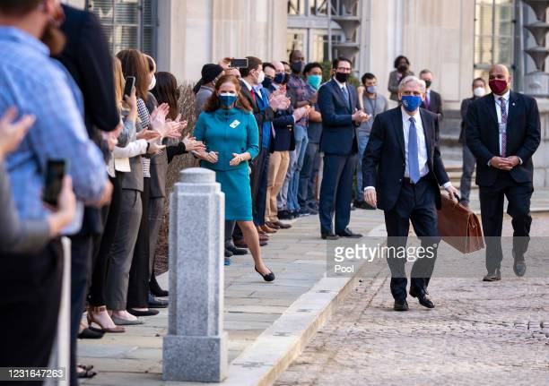 Newly confirmed U.S. Attorney General Merrick Garland is greeted by staff while his wife Lynn looks on as he arrives for his first day at the...