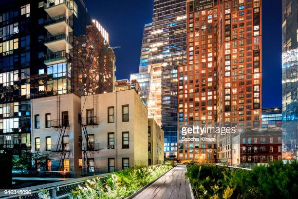 newly constructed and old buildings along the high line park - chelsea new york stock pictures, royalty-free photos & images
