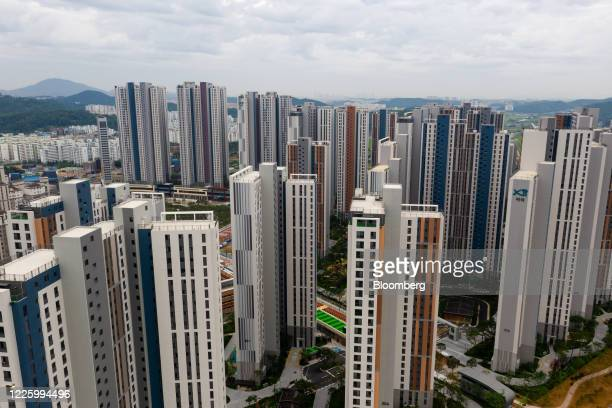 Newly constructed residential apartment buildings stand in this aerial photograph taken above Gimpo, South Korea, on Friday, July 10, 2020. South...