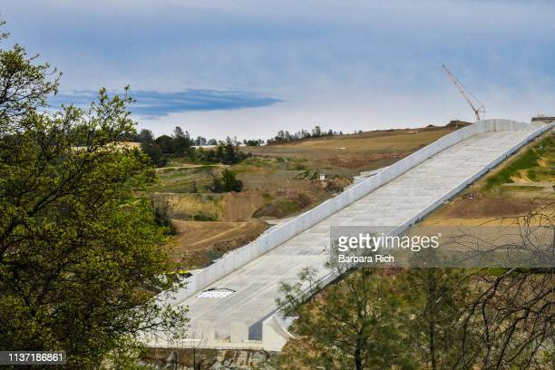 newly constructed spillway still under construction after disaster two years ago from excessive rains at oroville dam in oroville, california - after stock photos and pictures