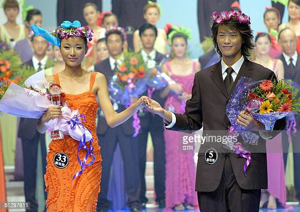 Newly crowned China's top models sixteenyearold Feng Jing and twenty twoyearold Mu Chonghua pose at the final of the New Silk Road Model pageant in...