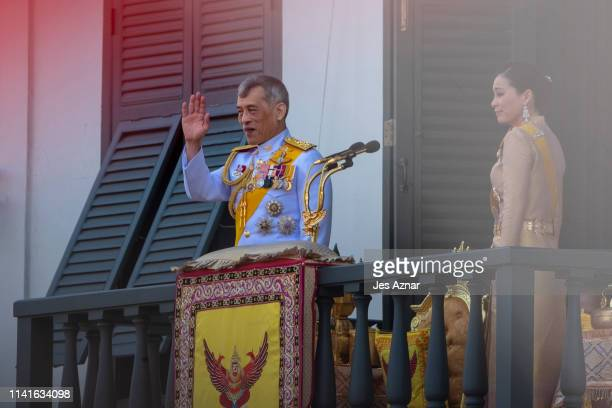 Newly crowned King Maha Vajiralongkorn addresses the crowd as Queen Suthida standing beside him on a balcony at the Grand Palace on May 6 2019 in...