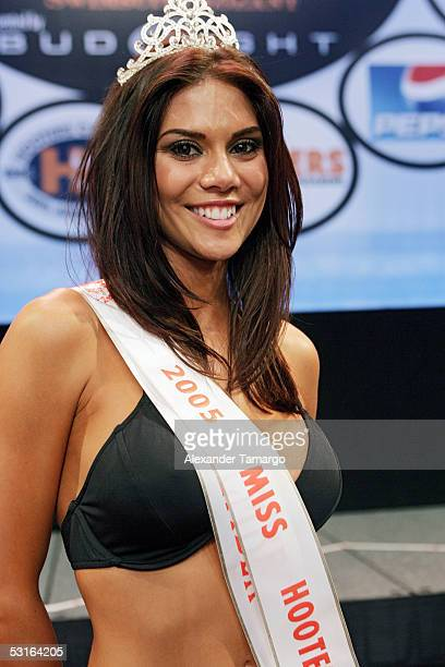 Newly crowned Miss Hooters International Anna Burns poses during the 2005 Hooters International Swimsuit Pageant at the Jackie Gleason Theatre for...