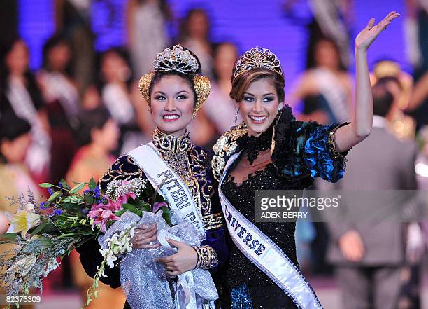 Newly crowned Miss Putri Indonesia Zivanna Letisha Siregar and Miss Universe 2008 Dayana Mendoza of Venezuela wave to the audience during the...