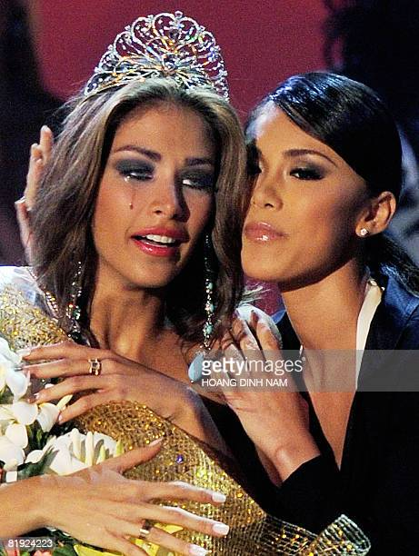 Newly crowned Miss Universe 2008 Dayana Mendoza Miss Venezuela cries as she is hugged by Miss Universe 2007 Miory Mori at the final of the 57th Miss...
