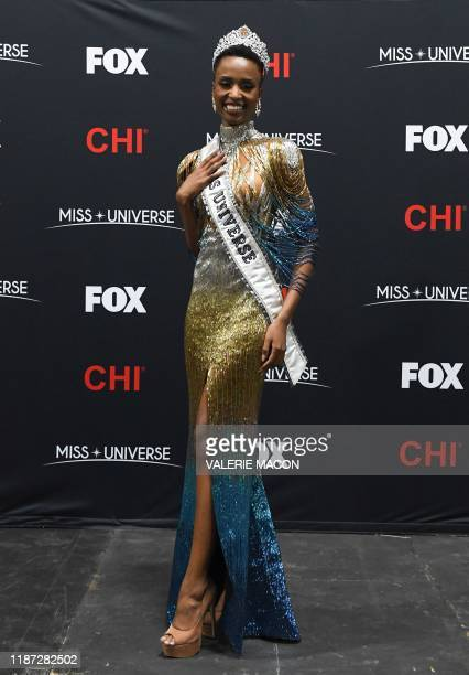 Newly crowned Miss Universe 2019 South Africa's Zozibini Tunzi poses during a press conference after the 2019 Miss Universe pageant at the Tyler...