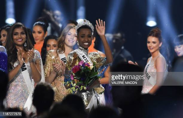Newly crowned Miss Universe 2019 South Africa's Zozibini Tunzi waves from stage after the 2019 Miss Universe pageant at the Tyler Perry Studios in...