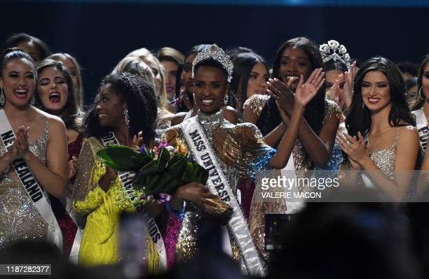 TOPSHOT Newly crowned Miss Universe 2019 South Africa's Zozibini Tunzi waves from stage after the 2019 Miss Universe pageant at the Tyler Perry...