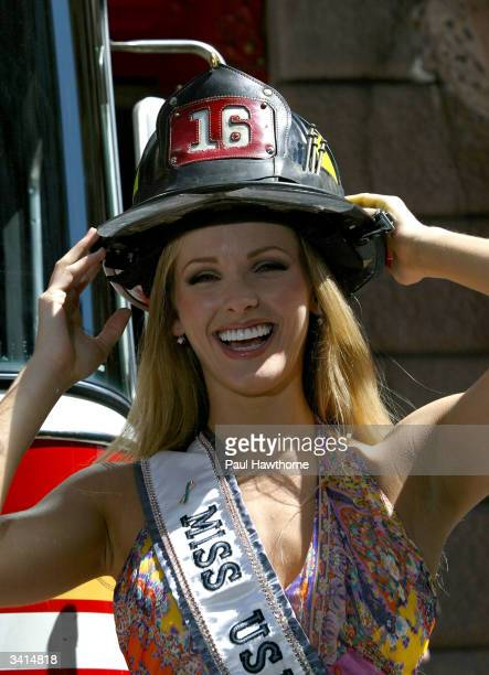 Newly crowned Miss USA 2004 Shandi Finnessey arrives at FDNY's engine 39 and ladder 16 firehouse on Manhattan's Upper East Side April 16 2004 in New...