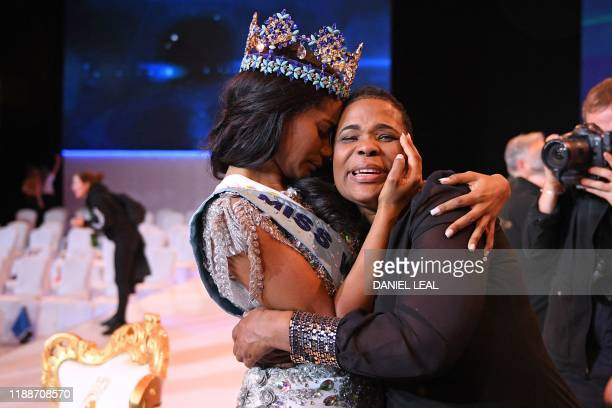 Newly crowned Miss World 2019 Miss Jamaica ToniAnn Singh embraces her mother during the Miss World Final 2019 at the Excel arena in east London on...