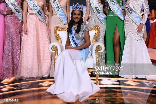 TOPSHOT Newly crowned Miss World 2019 Miss Jamaica ToniAnn Singh smiles as she poses with her crown during the Miss World Final 2019 at the Excel...