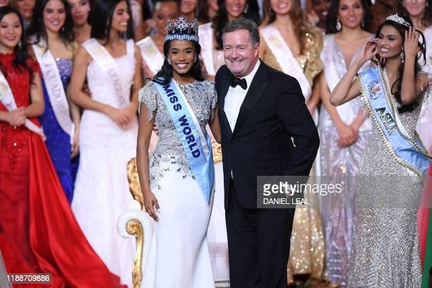 Newly crowned Miss World 2019 Miss Jamaica ToniAnn Singh smiles as she poses with TV presenter Piers Morgan during the Miss World Final 2019 at the...