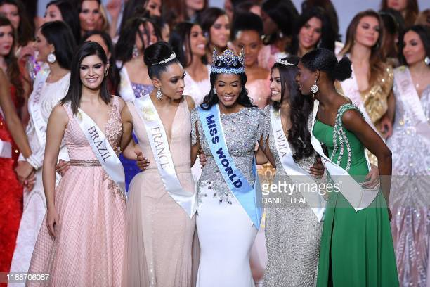 Newly crowned Miss World 2019 Miss Jamaica ToniAnn Singh smiles with her runnersup during the Miss World Final 2019 at the Excel arena in east London...