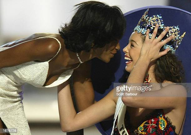 Newly crowned Miss World Miss Turkey Azra Akin is congratulated by Miss World 2001 Agbani Darego from Nigeria at the Miss World 2002 competition...